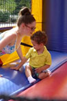 Woman with child in moon bounce